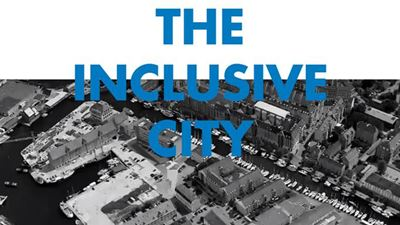 "Illustration where the text says ""The Inclusive City"" on top of an aerial view of a city. Photo/illustration: NCC"