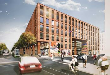The Fredriksberg offices at daylight, with brown cinder facades. Photo/illustration: N/A