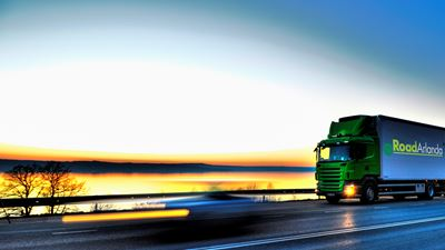 A truck zooms past the road with the dawning horizon and sea in the background. Photo/illustration: N/A