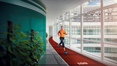 A person runs in an indoor running track, inside an office building. Photo/illustration: Getty Images