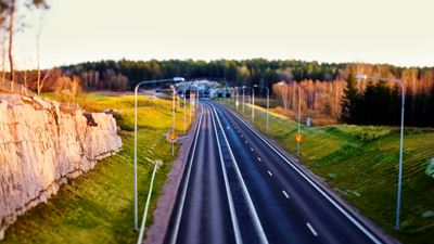 Overview of an expressway going towards the distant settlement and forest. Photo/illustration: Bruno Ehrs