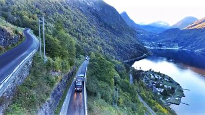 A working truck is paving the road stretch of Geiranger, going through the massive fjords and mountains of Norway. Photo/illustration: N/A